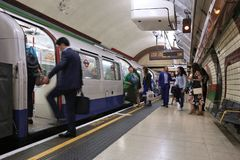 London subway train. LONDON, UK - JULY 6, 2016: People board the underground train in London. London Underground is the 11th busiest metro system worldwide with Royalty Free Stock Photo
