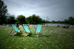 London Summer. Deck chairs in Regents Park London England Royalty Free Stock Image