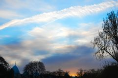 London sunset with wispy cloud and silhouettes stock photos