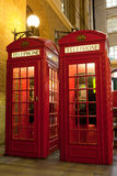 London symbol red phone box at illuminated street Stock Image