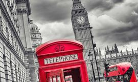 London symbols with big ben, double decker bus and red phone boo. View of a red phone booth with big ben and bus in the background at london in black and white Stock Image