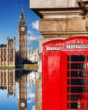London symbols with BIG BEN and red PHONE BOOTHS in England Royalty Free Stock Photos