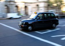 London Taxi. London black cab motion blur photo Stock Photography