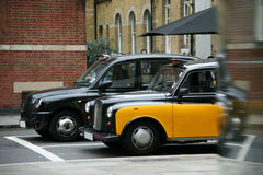 London Taxi. Taxi in the street of London. Cabs, Taxis, are the most iconic symbol of London as well as London's Red Double Decker Bus Stock Photography