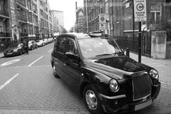 London Taxi. Taxi in the street of London. Cabs, Taxis, are the most iconic symbol of London as well as London's Red Double Decker Bus Stock Photo