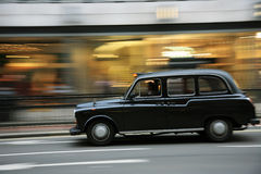 London Taxi. Taxi in the street of London. Cabs, Taxis, are the most iconic symbol of London as well as London's Red Double Decker Bus Royalty Free Stock Photo
