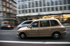 London Taxi. Taxi in the street of London. Cabs, Taxis, are the most iconic symbol of London as well as London's Red Double Decker Bus Royalty Free Stock Photography
