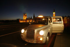 LONDON TAXI. LONDON - December 18, 2011 : A TX4 Hackney Carriage, also called London Taxi or Black Cab, at Westminster Bridge. TX4 is manufactured by the London Stock Photos