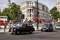 London Taxi. TX4 Hackney Carriage, also called London Taxi or Black Cab, at Strand on May 23, 2012 in London, UK. TX4 is manufactured by the London Taxi Company Royalty Free Stock Image