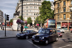 London Taxi. TX4 Hackney Carriage, also called London Taxi or Black Cab, at Strand on May 23, 2012 in London, UK. TX4 is manufactured by the London Taxi Company Royalty Free Stock Photography