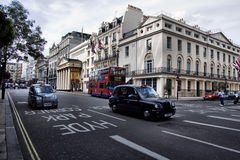 London Taxi. TX4 Hackney Carriage, also called London Taxi or Black Cab, at Strand on May 23, 2012 in London, UK. TX4 is manufactured by the London Taxi Company Stock Photography