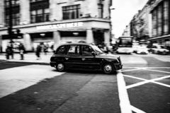 London taxi in black and white picture royalty free stock photo