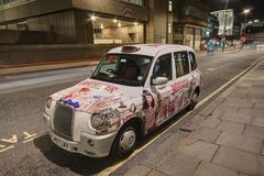 London Taxi Cab with advertising paintwork Stock Photo