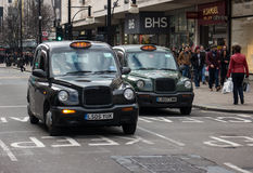 London Taxi Cab. Classic Taxi Cab on the street in London, UK Royalty Free Stock Images