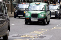 Four London Taxi Cabs Stock Photography