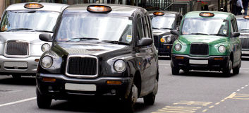 Five London Taxi Cabs. In Canary Wharf Royalty Free Stock Photo