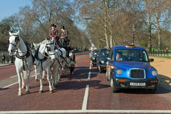 London Taxi and horse carrige Royalty Free Stock Photography
