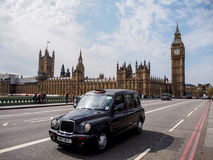 London taxi and the most famous landmark Big Ben Stock Images