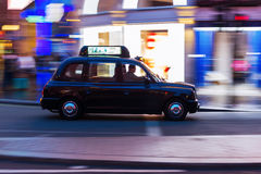 London taxi in motion blur at night Stock Images