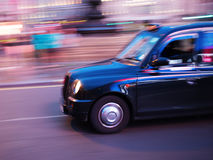 London taxi in motion blur at night Royalty Free Stock Images