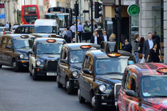 London Taxi. On October 03, 2014 in London, UK. Traditionally Taxi cabs are all black in London but now produced in various colors Royalty Free Stock Images