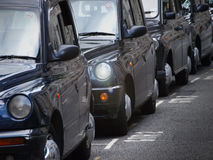 London Taxi Rank. With cabs waiting for fares Stock Photos