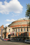 London taxi and Royal Albert Hall. London, UK - May 26, 2013 : London Taxi, also called hackney carriage, black cab, Royal Albert Hall in the background, people Royalty Free Stock Image