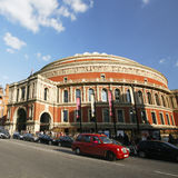 London taxi and Royal Albert Hall. London, UK - May 26, 2013 : London Taxi, also called hackney carriage, black cab, Royal Albert Hall in the background, people Royalty Free Stock Photos