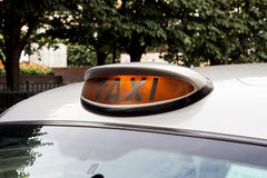 London Taxi Sign. The iconic London taxi cab sign, indicating it is vacant and available for hire Stock Photography