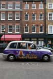 London taxi and traditional architecture. LONDON, GREAT BRITAIN, April 21, 2018 : Hackney carriage or Black Cab in the streets of London. In the United Kingdom Royalty Free Stock Photo