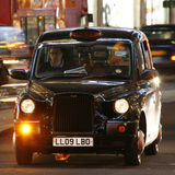 London Taxi, TX4. London, UK - December 4, 2013: London Taxi, TX4, also called hackney carriage, black cab. Traditionally Taxi cabs are all black in London but Royalty Free Stock Photo