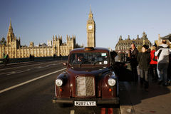London Taxi on Westminster Bridge Stock Photo