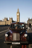 London Taxi on Westminster Bridge Royalty Free Stock Image