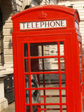 London telephone box. A characteristic red telephone box in a London street royalty free stock photography