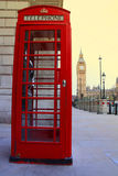 London telephone box and Big Ben in background Royalty Free Stock Photo