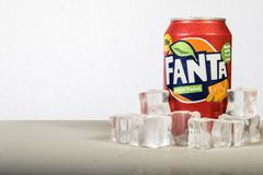 A can of chilled Fanta with ice against a white background Royalty Free Stock Photos