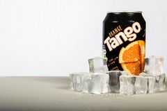 A can of chilled Orange Tango with ice against a white backgroun Stock Image