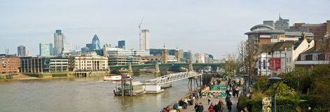 London Thames. Globe Theater overlooking the Thames and City of London skyline in the background, London stock image