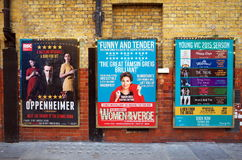 London Theatre Posters. London, England - April 16, 2015: Billboard posters on a brick wall advertising musicals and plays in the West End of London. In 2013 Stock Photos