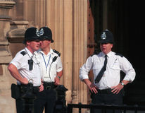 London three police men. A group of three police men by the british parliament in London Stock Photography