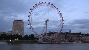 London Time Lapse with London Eye and Tourist Ship Sailing on Thames River stock video footage