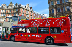 London Tour buse. LONDON, UK - MAY 14 2015:London Tour buse.It's a bus service that takes visitors sightseeing, with routes around tourist attractions in London Royalty Free Stock Photo