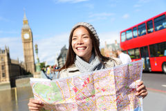 London tourist woman sightseeing holding map. London tourist woman on Europe travel sightseeing holding map by Big Ben and red double decker bus. Tourism people Royalty Free Stock Photo
