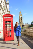 London tourist woman walking by red telephone box Royalty Free Stock Image