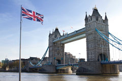 London Tower Bridge and British flags in UK Stock Images