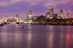 London. Tower Bridge and City of London by night Thames River Europe Stock Photo