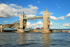 London Tower Bridge in evening light with white clouds stock image