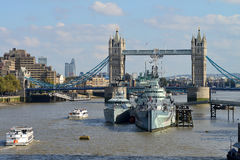 London Tower Bridge. And HMS Belfast on October 03, 2014 in London, UK. London is one of the world's leading tourism destinations Royalty Free Stock Images