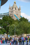 LONDON, Tower bridge and lots of walking people on south bank Royalty Free Stock Photo