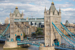 LONDON, Tower bridge and lots of walking people on south bank Stock Photography
